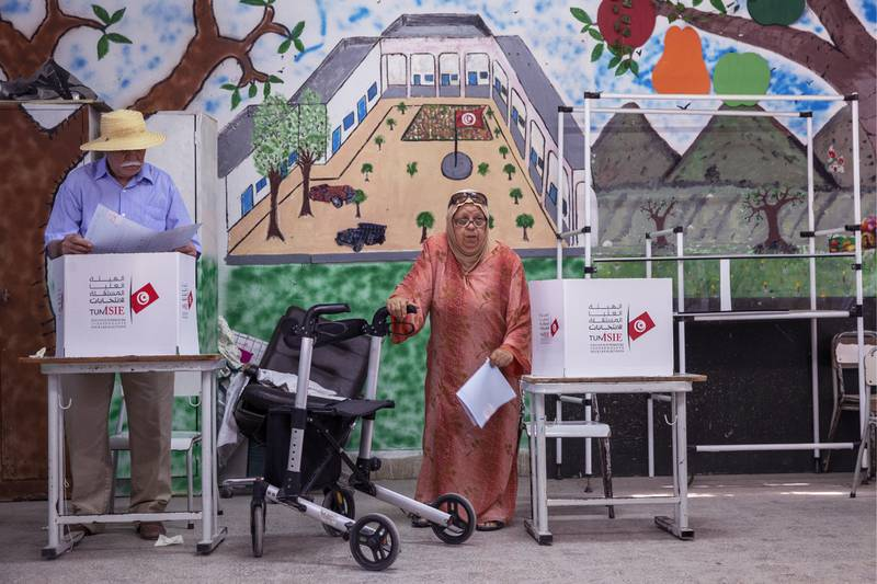 BEN AROUS, TUNISIA - OCTOBER 6: Tunisians cast their vote at a polling station during the parliamentary elections in Ben Arous, Tunisia on October 6, 2019.  (Photo by Yassine Gaidi/Anadolu Agency via Getty Images)