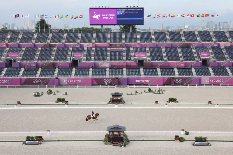 TOKYO, JAPAN - JULY 28: Brittany Fraser-Beaulieu of Team Canada riding All In competes in the Dressage Individual Grand Prix Freestyle Final in front of empty stands on day five of the Tokyo 2020 Olympic Games at Equestrian Park on July 28, 2021 in Tokyo, Japan.