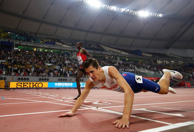 DOHA, QATAR - SEPTEMBER 30: Jakob Ingebrigtsen of Norway falls across the finish line in the Men's 5000 metres final during day four of 17th IAAF World Athletics Championships Doha 2019 at Khalifa International Stadium on September 30, 2019 in Doha, Qatar. (Photo by Patrick Smith/Getty Images)