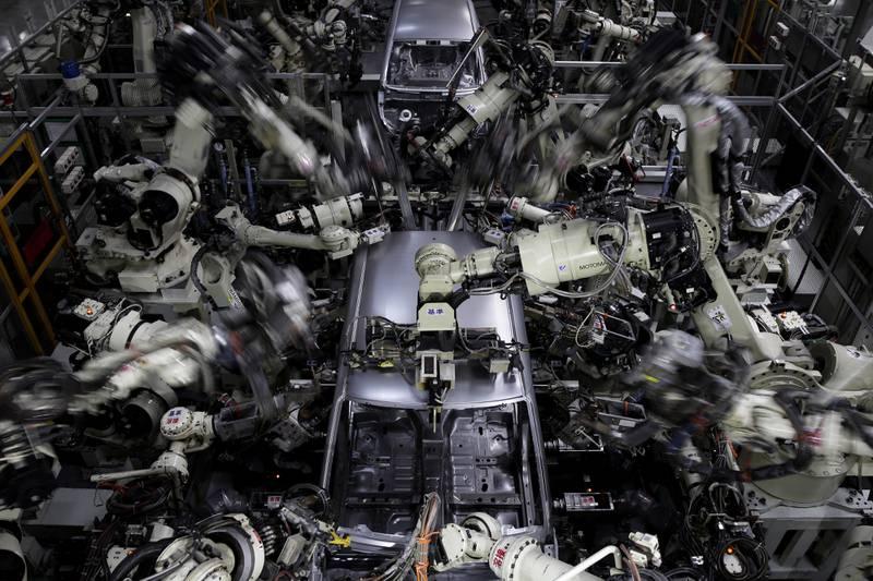 Robotic arms weld the body frames of Daihatsu Motor Co. vehicles on the production line of the Daihatsu Motor Kyushu Co. Oita (Nakatsu) plant in Nakatsu, Oita Prefecture, Japan, on Wednesday, April 6, 2016.