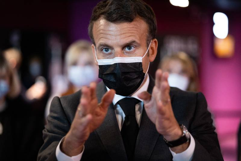 rench President Emmanuel Macron speaks with youth during a visit to the Mazarin cinema to mark launch of the cultural pass and the reopening of cultural activities after closures to fight the Covid-19 pandemic, in Nevers, central France, on May 21, 2021