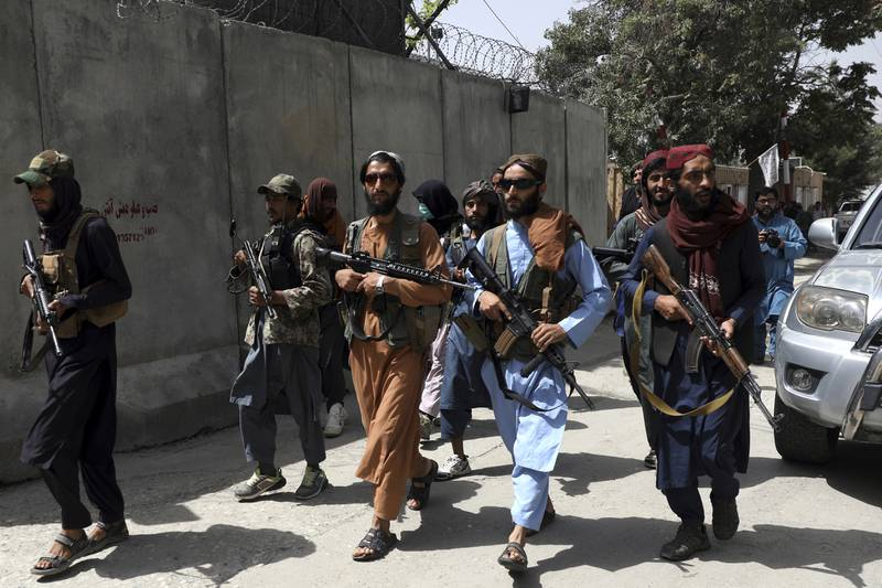 """Taliban fighters patrol in Wazir Akbar Khan neighborhood in the city of Kabul, Afghanistan, Wednesday, Aug. 18, 2021. The Taliban declared an """"amnesty"""" across Afghanistan and urged women to join their government Tuesday, seeking to convince a wary population that they have changed a day after deadly chaos gripped the main airport as desperate crowds tried to flee the country. (AP Photo/Rahmat Gul)"""