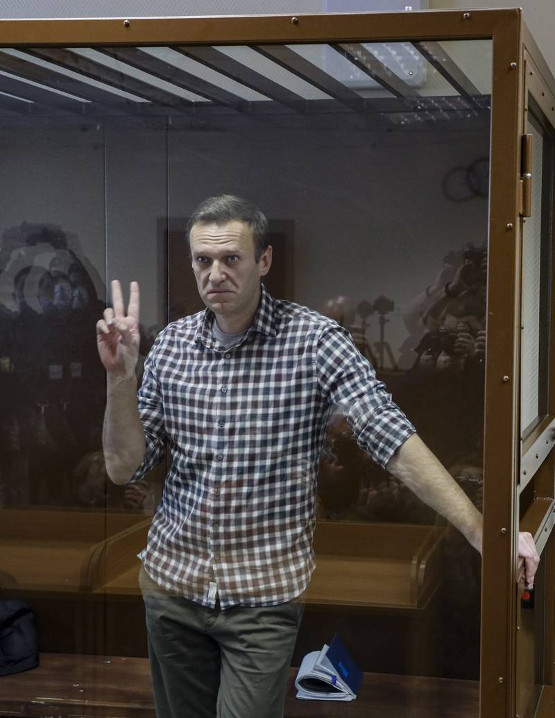 Russian opposition leader Alexei Navalny gestures inside a glass cage prior to a hearing at the Babushkinsky District Court in Moscow, Russia, 20 February 2021. The Moscow City court will hold a visiting session at the Babushkinsky District Court Building to consider Navalny's lawyers appeal against a court verdict issued on 02 February 2021, to replace the suspended sentence issued to Navalny in the Yves Rocher embezzlement case with an actual term in a penal colony.