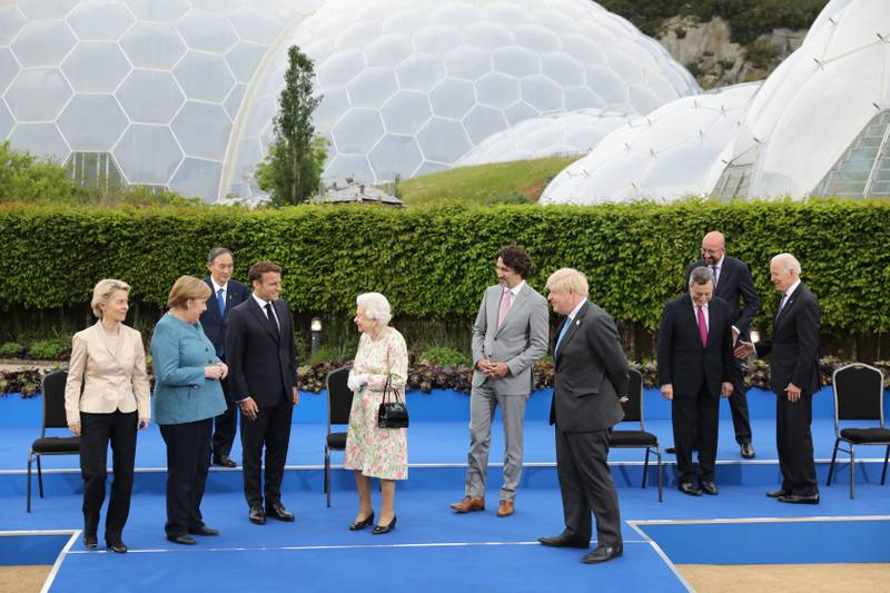 ST AUSTELL, ENGLAND - JUNE 11: (L-R) European Commission Ursula von der Leyen, German Chancellor Angela Merkel, Italian Prime Minister Mario Draghi , French President Emmanuel Macron, Queen Elizabeth II, Canadian Prime Minister Justin Trudeau, British Prime Minister Boris Johnson, Japanese Prime Minister Yoshihide Suga, President of the European Council Charles Michel and United States President Joe Biden attend a drinks reception for Queen Elizabeth II and G7 leaders at The Eden Project during the G7 Summit on June 11, 2021 in St Austell, Cornwall, England. UK Prime Minister, Boris Johnson, hosts leaders from the USA, Japan, Germany, France, Italy and Canada at the G7 Summit. This year the UK has invited India, South Africa, and South Korea to attend the Leaders' Summit as guest countries as well as the EU. (Photo by Jack Hill - WPA Pool / Getty Images)