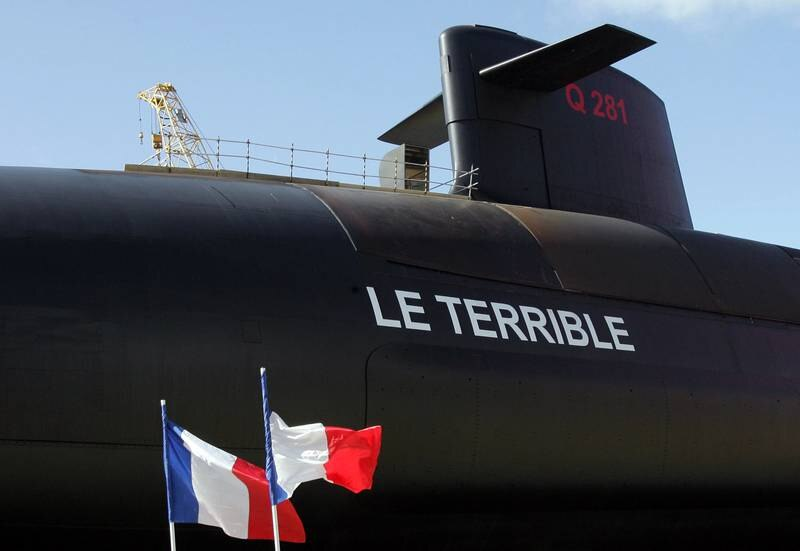 """FRANCE - MARCH 21:  French flags fly during the launch of the country's latest and fourth nuclear-powered submarine, """"Le Terrible,"""" in Cherbourg, France, on Friday, March 21, 2008. President Nicolas Sarkozy affirmed at the launch France's commitment to a strategy of nuclear deterrence, saying that countries in the Middle East and Asia are developing missiles that pose a threat to Europe.  (Photo by Judith White/Bloomberg via Getty Images)"""