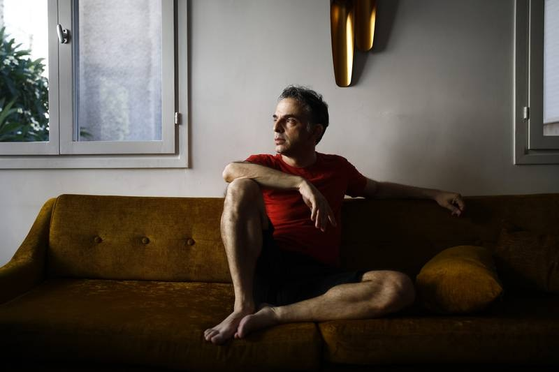 Israeli writer Etgar Keret in his home in Tel Aviv, Israel, Aug. 15, 2019. Keret, the writer of absurd, sad, funny and very short stories, grows up.